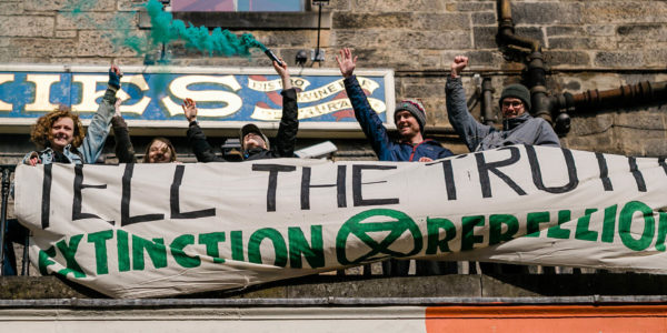 XR Scotland rebels with banner saying: Tell the Truth