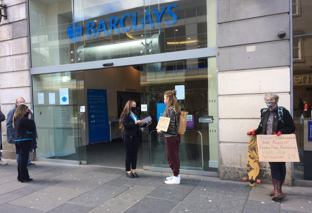 Extinction Rebellion Glasgow activists deliver a letter to the manager of a Barclays branch - 5 May 2021