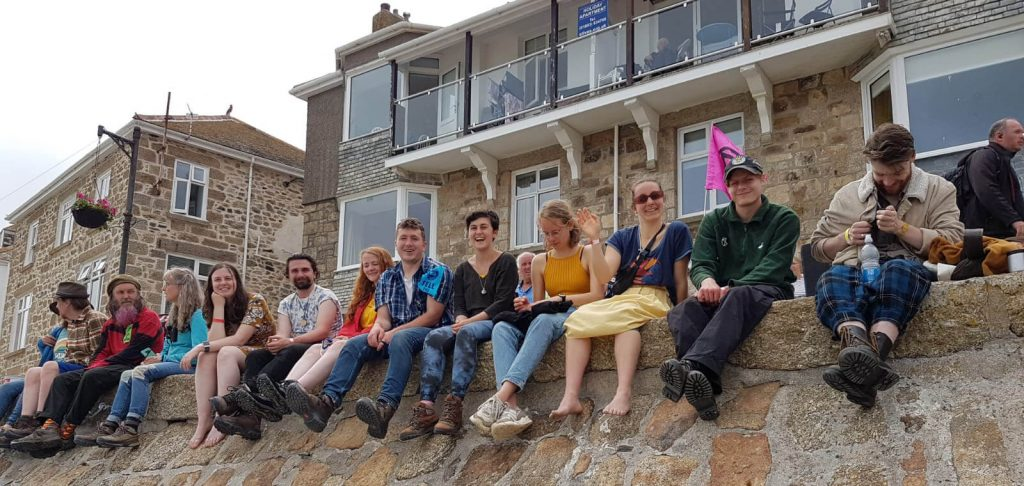 Group of people sitting on a wall